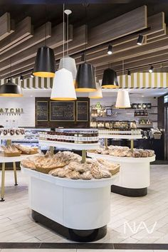 This elegant design by MetaSpace features Navurban Toorak decor installed on the ceiling beams of Satchi Patisseries, Melbourne. Supermarket Design, Aged Care, Ceiling Beams, New Age, Gas Station, Melbourne, Destinations, Commercial, Retail