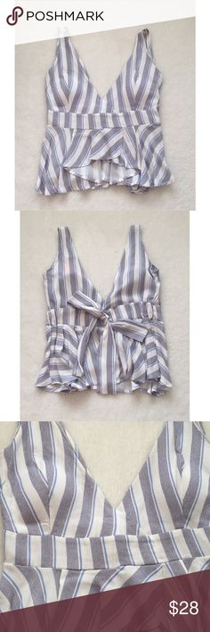🆕 Striped Top Striped top- V neck, with built in padding. Brand new with tag. a'gaci Tops