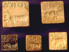 Stone seals inscribed with animals and Indus script. Harappan Civilization, 3000-1500 BC