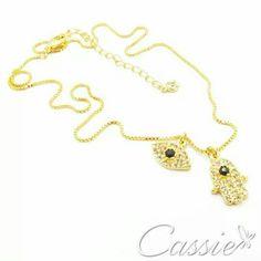Colar Amuletos folheado a ouro com dois pingentes - um olho grego e um hamsa - cravejado de zircônias.  : R$ 57,90 em até 10x sem juros.  ▪⚪▪⚪▪⚪▪⚪▪⚪▪⚪▪⚪▪⚪▪⚪ #Cassie #semijoias #acessórios #moda #fashion #estilo #inspiração #tendências #trends #brincos #garantia #brincoslindos #love #pulseirismo #lookdodia #zircônias #folheado #dourado #brincoleque #brincoleve #colar #pulseiras #maxibrinco #anellove #anelfalange