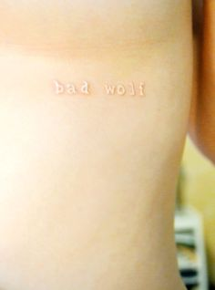simple quote white ink tattoo - bad wolf <--- oh my gosh Doctor Who! I love this!