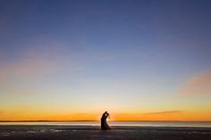 Rachel & Peter share a kiss on Sunset beach.  Picture courtesy of Envision Photography  #fraserislandweddings #beachwedding #destinationwedding