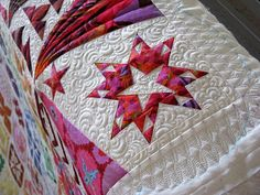 A corner on a Dear Jane quilt using Kaffe Fassett cloth