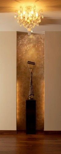silver and gold leaf adorn this art niche at the entrance to a penthouse