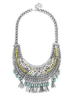 """A true hero of a necklace: Edgy antique silver chain, intricate stone work, punches of neon and festive fringe come together in a statement that's just as bold as is it is femme. Necklace measures 16"""" with 2"""" extension."""