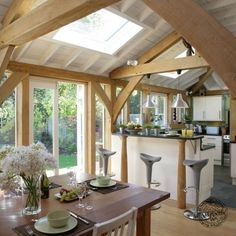 Open Plan Kitchen and Dining Room Interior with Exposed Oak Primary Frame
