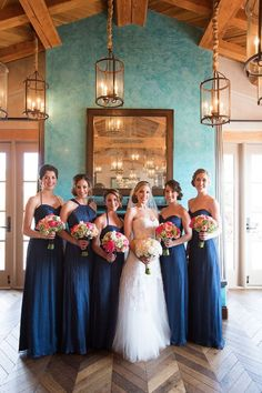 Amsale Bridesmaids in various styles of French Blue chiffon. Photo by Samuel Lippke Studios
