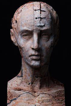 TESTA IV (2014).  Stone, iron and wax / Pietra, ferro e cera, cm 20 x 22 x 40.