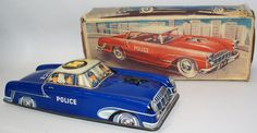 Vintage Tin Lithographed Friction Powered #470 Police Car by Philip Neidermeier (PN Toys). Made in Western Germany. Beautiful bright lithography! Friction works perfectly! Blue body with cream roof an