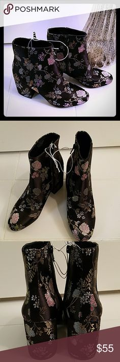 Carlos by Carlos Santana Gatlin Boots Carlos by Carlos Santana Gatlin Boots. These fabulous floral print boots features 3 inch blocked Heels and an inside zipper. They are simply beautiful . Size 7 M Carlos Santana Shoes Ankle Boots & Booties