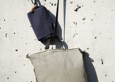 """The shape shifting and water resistant main body can lean towards a tote bag or take on the look of a more square backpack. Small and inside pockets, plus a Merino felt-lined sleeve which fits up to 16"""" MacBook Pro® help to organize content. The YKK® metal zippers with cotton- instead of the usual plastic tape allow direct top- as well as side-access to the main compartment. The modular handle and adjustable backpack straps provide versatile carrying options. - picture by Matthias Graf© Backpack Straps, Drawstring Backpack, Vegetable Tanned Leather, Macbook Pro, New Product, Backpacks, Pure Products, Zip, Tote Bag"""