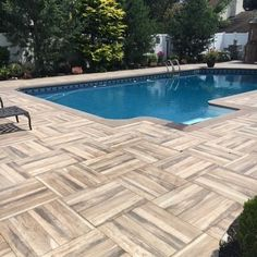 While we most of us can't spend our gorgeous summer days it at the beach, we can still relax in our own backyards! Our outdoor pavers are the perfect tile for your pool areas. Have a sample sent to your home so you can test it out today! Outdoor Pavers, Outdoor Tiles, Outdoor Decor, Wood Look Tile, Porcelain Tile, Pathways, Relax, Warm, Backyards