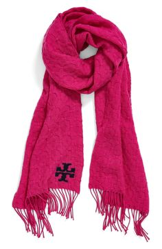 Bright pink and beautiful! This Tory Burch whipstitched merino wool scarf is a fall staple.