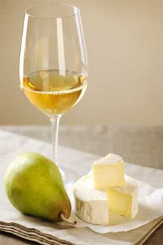 Perfect way to unwind on a warm summer night. White wine, cheese, and pears.