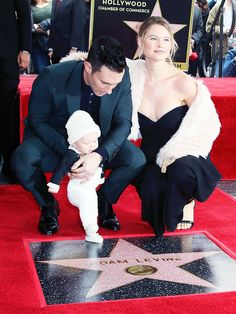 Behati Prinsloo and Adam Levine take baby daughter Dusty Rose on her first public outing on the Hollywood Walk of Fame.