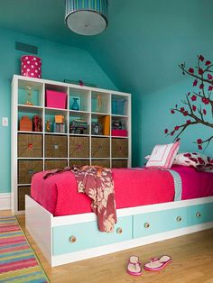 Storage for Kids - Cubbyholes grow up and adapt to tween and teen storage needs. Square baskets fit into the cubbies of this wall shelving unit and give everything a concealed storage spot. Upper cubes provide display space within the same unit. For more kids room decorating and organizing ideas visit
