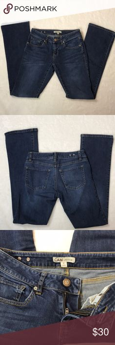 CAbi Flare Jeans Size 0 CAbi Flare Denim Jeans  Size 0 - please see photo for measurements   Medium wash   Good Used Condition: Light pilling on the thigh area and gentle general wear   Smoke free home CAbi Jeans Flare & Wide Leg