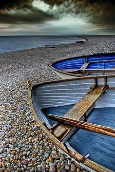 Blue boats, gray sky