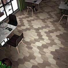 The Egurra porcelain floor and wall tile in hex irr ebano offers the look of a hardwood floor with the durability of a tile. With a varying wood grain design in dark browns, these hexagonal tiles offer the versatility to be used in traditional or modern settings. These impervious tiles have a matte finish and are great for use in indoor or outdoor settings.
