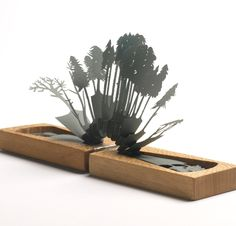 Lizzie Thomas Hidden Forest: a wooden book holding a hand cut paper pop up scene inside. I'm thinking of using this idea as a pop-up card atop a plain looking gift box, a nice surprise.