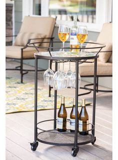 Mosaic Flower Serving Cart for $225.00 from WineRacks.com  Dimensions: 24 diameter x 33 high  This attractive serving cart has a colorful mosaic top and will hold bottles as well as stemware. Casters make the cart easy to move around.
