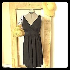 """Gap Stretch Black Sundress Gap Stretch Black Sundress. Size S measures flat: 18"""" across chest, 16"""" at waist, 35"""" long with tie at waist. Color is true black, closest to last pic. 95% viscose, 5% spandex.  0513/250/052115 GAP Dresses"""