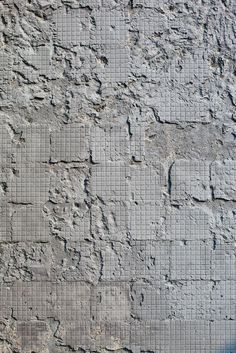 + | Looks like art - - Concrete wall after removal of the tiles ...