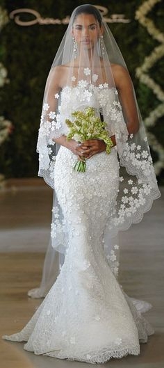 Oscar de la Renta Bridal 2013 - Ivory Chantilly leaf lace sweetheart gown with cascading snowflake lace applique.