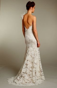 Love the fitted body, subtle train and low back. The lace I coud do without....