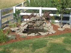 Garden and Patio, Small DIY Ponds With Waterfall And Stone Border In The Corner Backyard Garden House Design With Wooden Fence And Railings Ideas ~ Backyard Ponds with Waterfalls