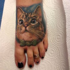 Cat tattoo on a foot