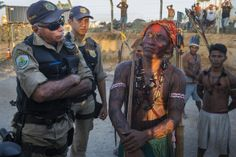 Indigenous Munduruku man & Federal Police argue during an occupation of the Belo Monte Dam.  Taylor Weidman | Photographer