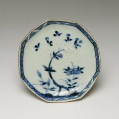 Small octagonal dish of porcelain, decorated in underglaze blue and stencilled slip with design of flowers: Japan, 1740-1799