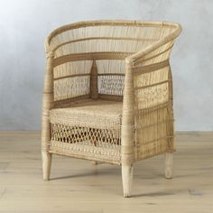 Shop woven malawi chair.   The natural beauty of Malawi basketry takes a modern seat in the sun, woven with a rich sense of cultural tradition.