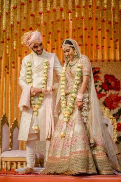 Imagine a royal wedding with picturesque backdrops, where the bride is dressed in a pristine white lehenga and the groom beautifully coordinates in a classic white Sherwani! Now couple that with do. Couple Wedding Dress, Wedding Dresses Men Indian, Indian Wedding Couple, Indian Bridal Outfits, Indian Bridal Fashion, Wedding Attire, Royal Indian Wedding, Indian Weddings, Wedding Hijab