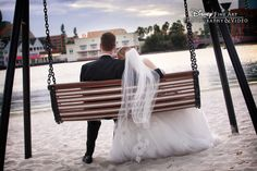 This sweet couple took a moment to relax and enjoy the scenery #Disney #wedding #BoardWalk. Photo: Amy, Disney Fine Art Photography