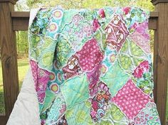 Amy Butler rag quilt - Soul Blossoms in Blis.  $249  I want to make one like this for Regan