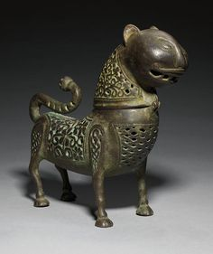 A CAST BRONZE INCENSE BURNER IN THE FORM OF A LION PROBABLY PUNJAB OR HINDUSTAN, CIRCA 14TH/15TH CENTURY
