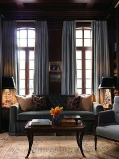 The colour scheme (dark and dramatic), the (lush) floor to ceiling curtains, the table lamps (black with ornate, 'crystal' bases)