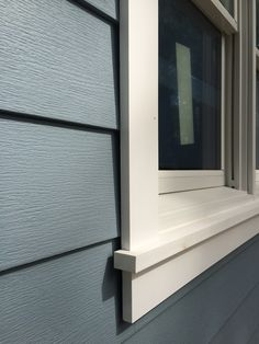 Installation of Royal Celect Siding with white color around the ...