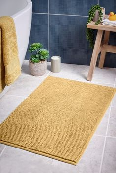 We offer our bobble mat range in a range of colours to suit your bathroom's theme. Made with polyester to give a durable finish and quick-drying properties Machine washable. Mustard Bath, Yellow Bath Mats, Gray And White Bathroom, Large Baths, Yellow Bathrooms, Bath Sheets, Bathroom Towels, Picture Design, Color Splash