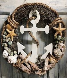 This is an 18 inch primitive country grapevine beach nautical wreath.- This is an 18 inch primitive country grapevine beach nautical wreath. It is acce… This is an 18 inch primitive country grapevine beach… - Coastal Wreath, Nautical Wreath, Nautical Rope, Beach Wreaths, Nautical Theme, Driftwood Wreath, Seashell Wreath, Seashell Projects, Seashell Crafts