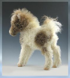 teeny pony.... I don't think this is needle felted, but it would translate nicely to needle felting I think...