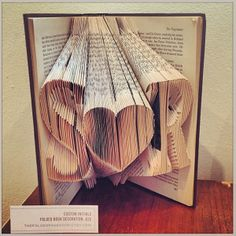 Amazing laser cut book art, discovered at the first ever Etsy UK Weddings Event.  Created by The Folded Page shp on Etsy http://www.thefoldedpageshop.etsy.com/.  From the Love My Dress Instagram feed  http://instagram.com/lovemydress