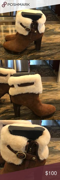 UGG boots Brown UGG boots with cream fold over fur! 4 inch heel! Never worn. UGG Shoes Ankle Boots & Booties