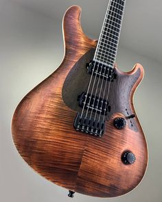 Mayones Regius CoreGuard 6 Master Builder Collection 2018 | Flamed Maple top | Pickguard shaped Wenge intarsia | Trans Antique Brown Matt top finish | Natural wood body top binding | Mahogany Khaya body wings | 11-ply neck-thru-body section | Trans Natural Matt back finish | Ebony fingerboard | Luminlay SGM-23 Super Green in Black pipe side dot markers | 24 Ferd Wagner jumbo frets | 3-ply White ABS / Gray Acrylic Pearl binding