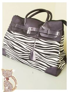 Mousse printed bag - Zibra pattern. Size : L39 x H27 x W18cm Price : US$79 Material: Polyester