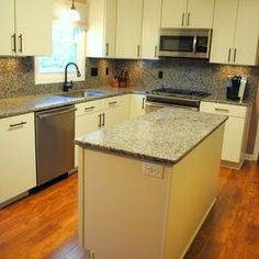 Traditional Kitchen Remodel with Caledonia Granite Tops and Backsplash by Hatchett Design/Remodel