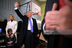Republican presidential nominee Donald Trump (C) waves after casting his vote with daughter Ivanka Trump (L) and her daughter Arabella Rose Kushner on Election Day at PS 59 November 8, 2016 in New York City. Trump's marathon final two days of campaigning marched through 10 cities in two days, stretching into Election Day.