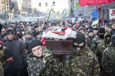 KIEV, UKRAINE - JANUARY 26: Anti-government protestors carry the body of Mikhail Zhiznevsky, 25, a protestor killed during clashes with police on Wednesday, towards Independence Square on January 26, 2013 in Kiev, Ukraine. Violent protests in Ukraine continue with opposition leaders rejecting President Viktor Yanukovych's offer to appoint them to top government posts. (Photo by Rob Stothard/Getty Images) 2014 Getty Images — at Kiev,Ukraine.